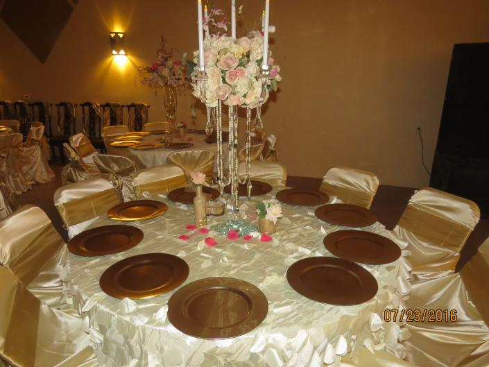 [Image: A wedding reception table setup at the venue.]