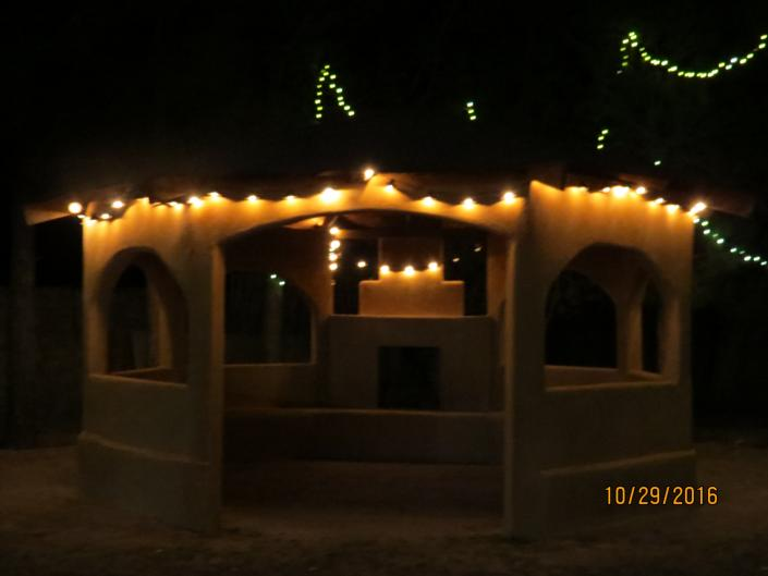 [Image: The extra details go a long way with our gazebo and fireplace decorated with fairy lights.]