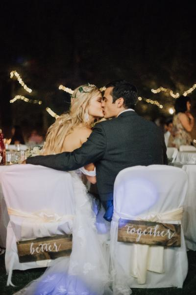 [Image: A beautiful moment between the bride & groom captured at their wedding reception.]