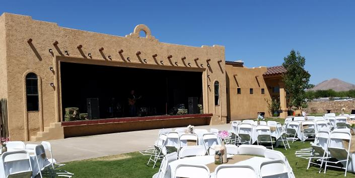 [Image: This outdoor wedding reception features a wonderful setup at the Grapevine Plaza.]